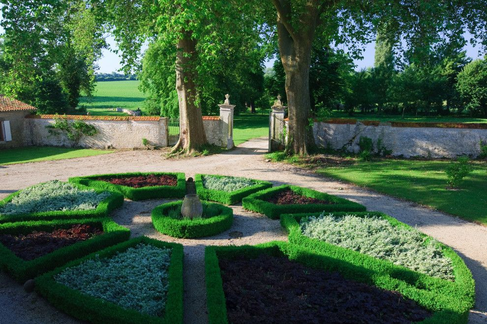 Needham Garden Center for a Traditional Landscape with a Circular Garden and Logis  De Grange, Grange, France by Joel Antunes Photography