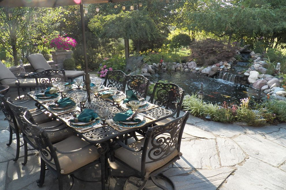 Neiman Marcus Cake for a Mediterranean Patio with a Hot Tub and Patio Table Set for a Barbeque by Spallina Interiors