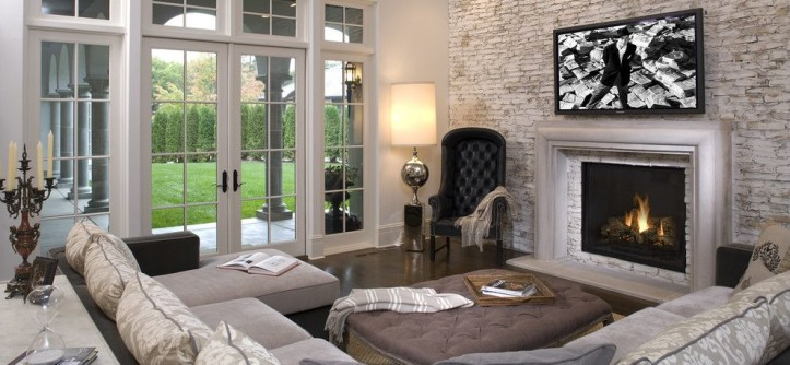 New Braunfels Theater for a Mediterranean Family Room with a Corner Sofa and Hollywood Chic Living Room by John Kraemer & Sons