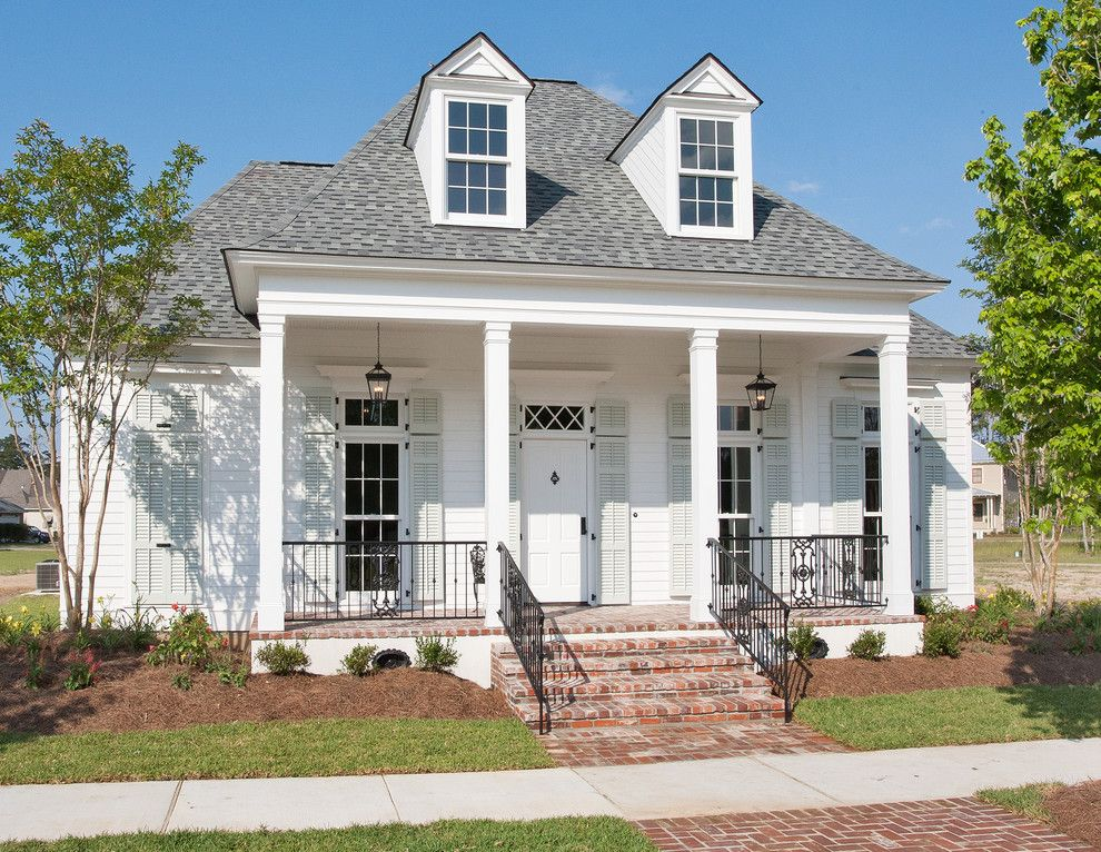 Newe for a Traditional Exterior with a Porch Lighting and New Orleans Charm with a Private Courtyard by Highland Homes, Inc.