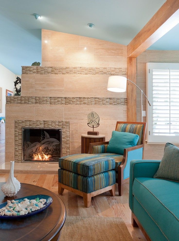 Nichols Hills Ok for a Tropical Family Room with a Vein Cut Travertine Fireplace and Tropical Retreat in Woodland Hills by Karen Grace Interiors