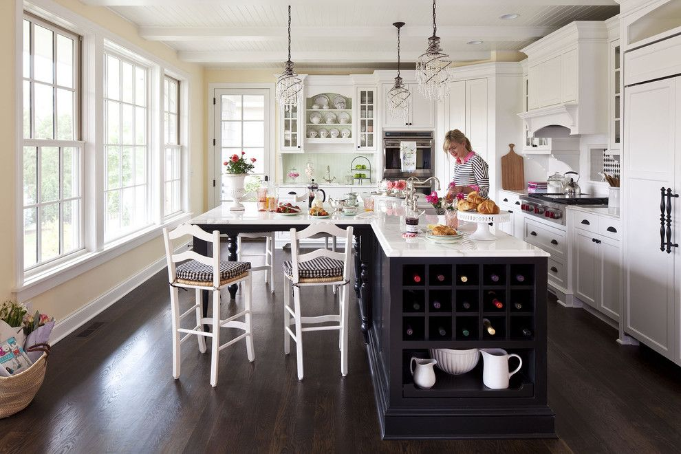 North Country Storage Barns for a Traditional Kitchen with a Black Island and Sunnyside Road Residence Kitchen 3 by Martha O'hara Interiors