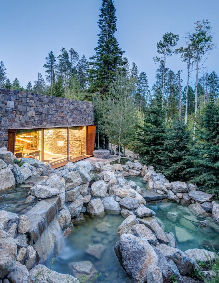 Nwnatural for a Rustic Landscape with a Stone Siding and Slopeside Wine Cellar by Carney Logan Burke Architects