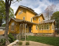 Oasis Ann Arbor for a Farmhouse Exterior with a Yellow Siding and Custom Homes by Phinney Design Group