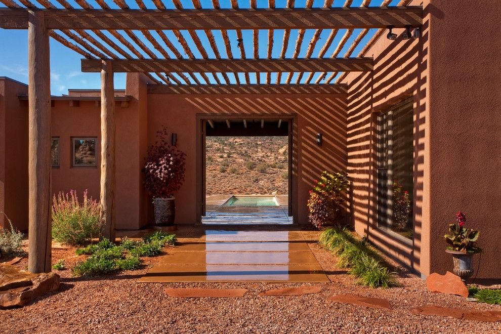 Odyssey House Utah for a Southwestern Entry with a Stucco and Moab Utah Vacation Home by Karen White Interior Design