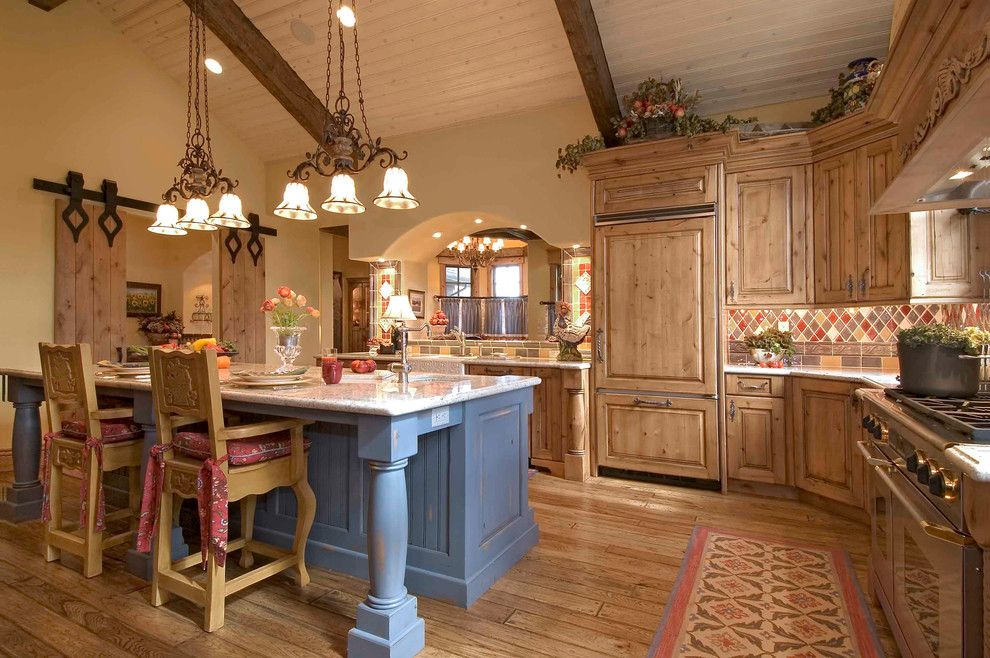 Old Masters Stain for a Rustic Kitchen with a Pendant Light and Keystone Ranch Home by Markel Design Group