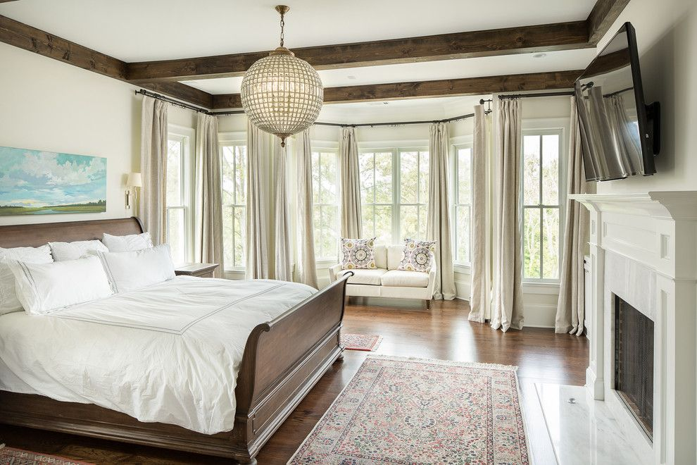 Old Masters Stain for a Traditional Bedroom with a Dark Wood Bed Frame and T-Olive Properties by David Cannon Photography
