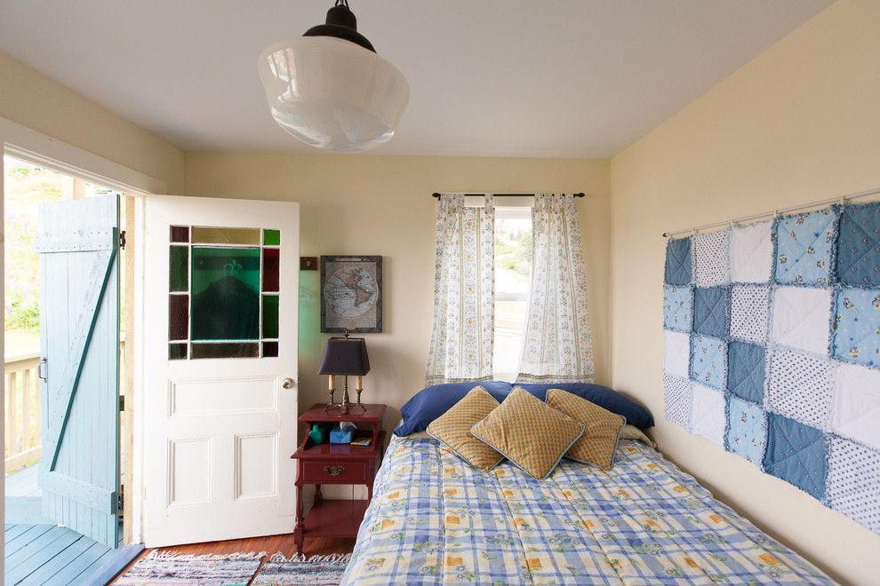 Ole Miss Housing for a Beach Style Bedroom with a Wall Hanging and Small Space Living in Outport Community, Port Rexton by Becki Peckham