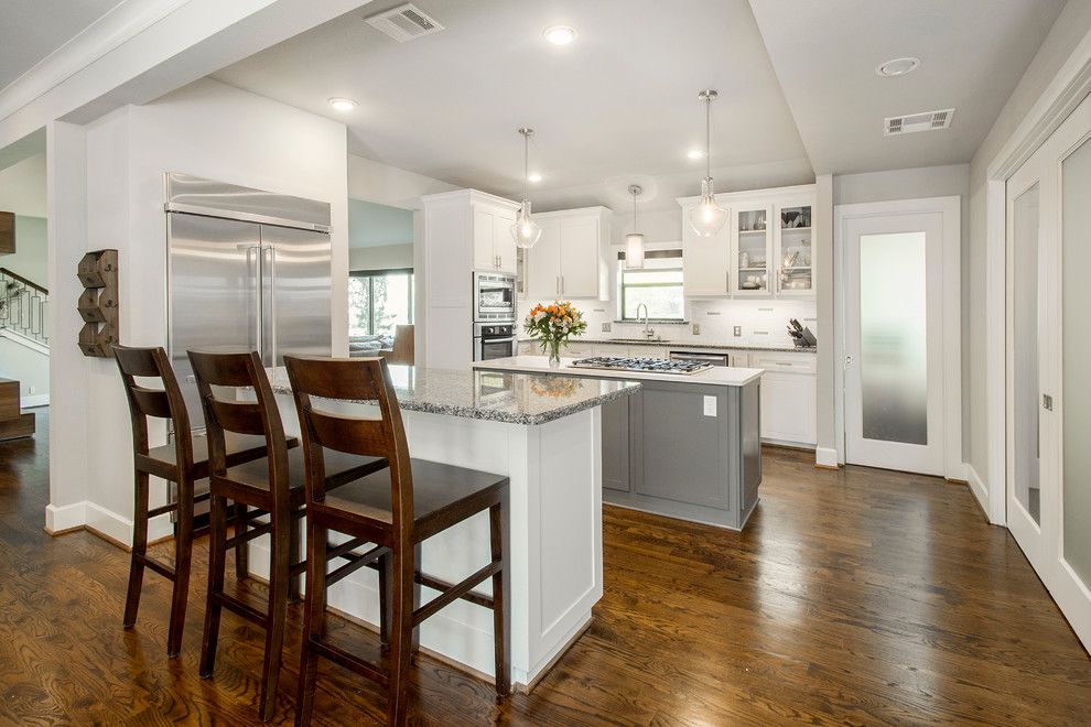 Onyx Dallas for a Midcentury Kitchen with a Lyndale Cabinets and Van Dyke Midcentury Modern Addition and Renovation by Hatfield Builders & Remodelers