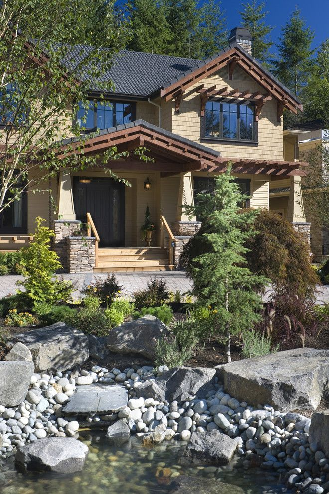 Oregon Decorative Rock for a Craftsman Exterior with a Entrance and Copper Falls by Alan Mascord Design Associates Inc