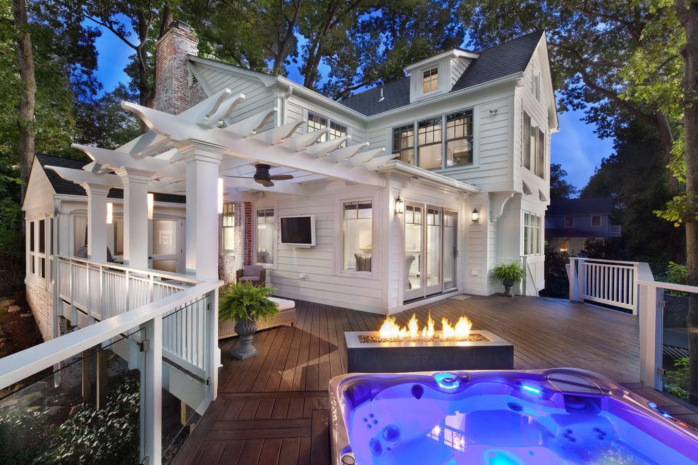Outdoor Basketball Courts Near Me for a Traditional Deck with a Wall Mounted Tv and Trimmed to Perfection by Anthony Wilder Design/build, Inc.