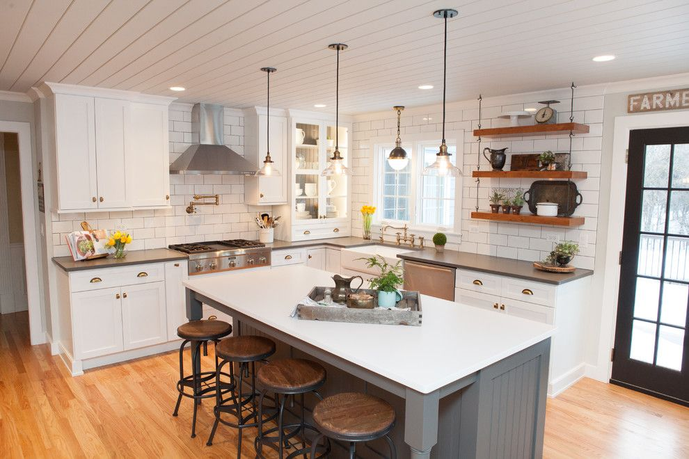 Pacific Energy Wood Stove for a Farmhouse Kitchen with a Pendant Lighting and Modern Kitchen Chicago by Joe Nowak Photography