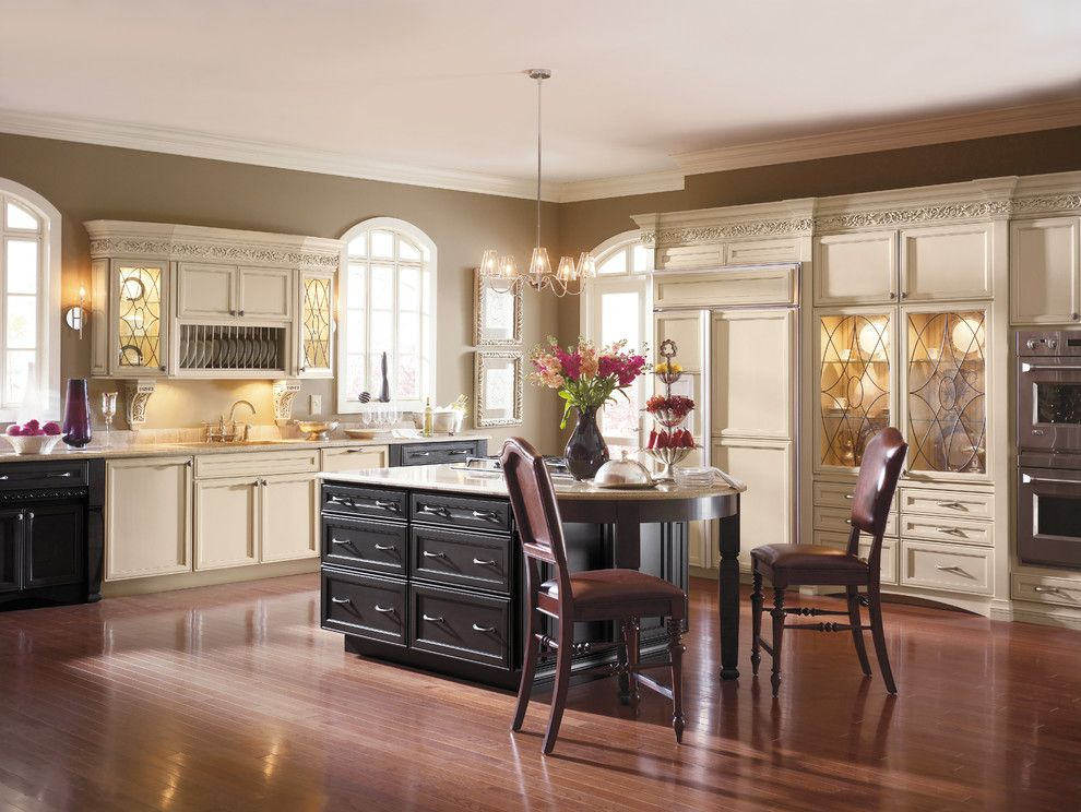 Pacific Energy Wood Stove for a Traditional Kitchen with a Crown Moulding and Kitchen Cabinets by Capitol District Supply