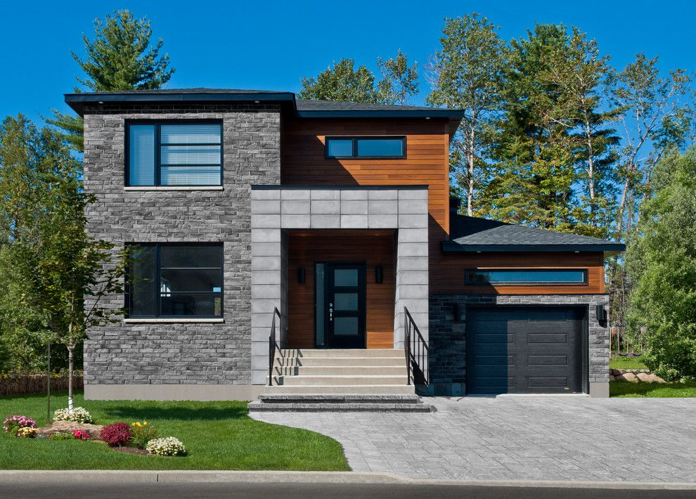 Paint Aluminum Siding for a Contemporary Exterior with a Yellow Flowers and Stone Products by Rinox Inc