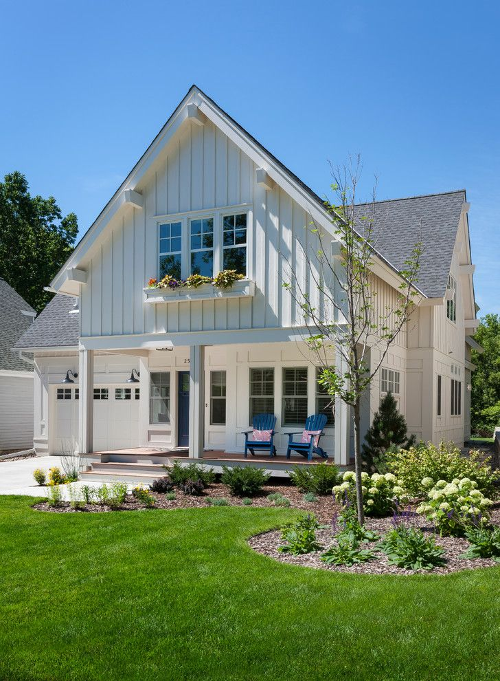 Painting Vinyl Siding for a Traditional Exterior with a Lawn and Kenwood Cottage by Peterssen/keller Architecture