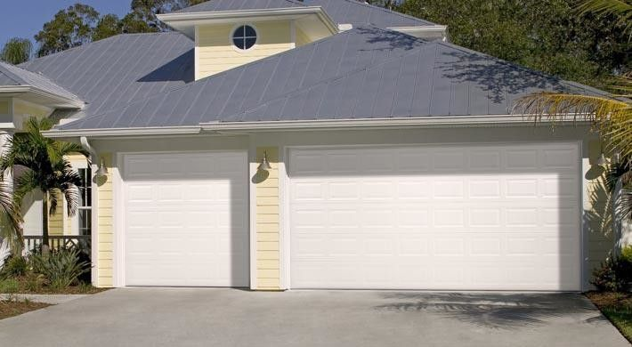 Palm Frond for a Beach Style Garage with a Gray Gutters and Raised Panel by Empire Overhead Doors, Llc
