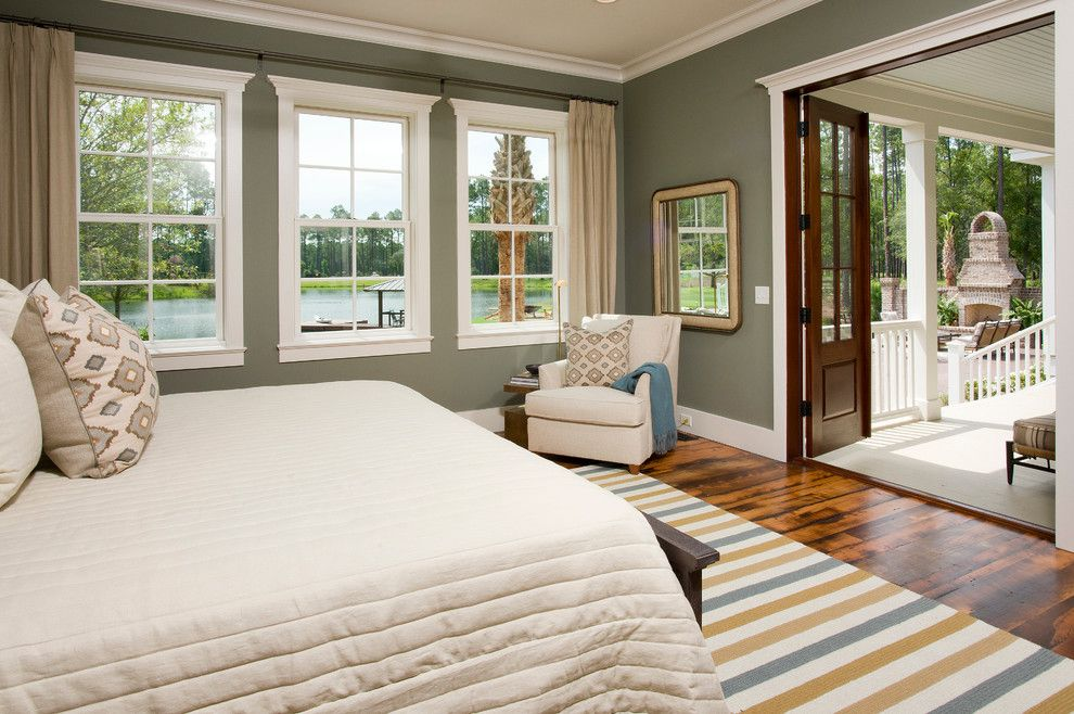 "Palmetto Bluff Sc for a Traditional Bedroom with a Striped Rug and the Page ""Palmetto Bluff Style Home"" by Shoreline Construction and Development"
