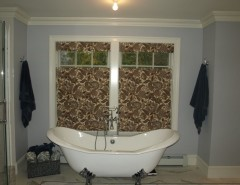 Paramus Lighting for a Traditional Bathroom with a Privacy Roman Shade and Masterbath by Budget Blinds of Paramus & Westwood
