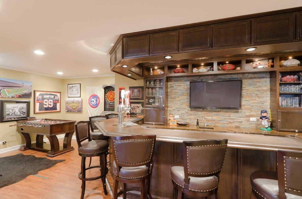 Pasargad for a Contemporary Basement with a Stone and Basement Fit for a Sports Fanatic by Synergy Builders Inc.
