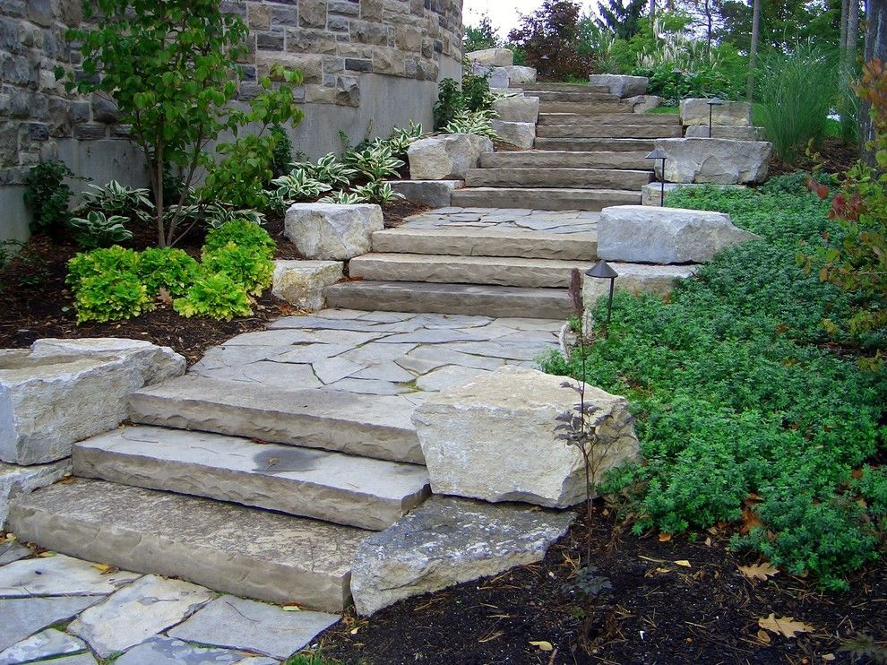 Pavestone for a Rustic Landscape with a Natural Stone Stairs and Country Squire Road by Ross Yantzi's Pavestone Plus Ltd.