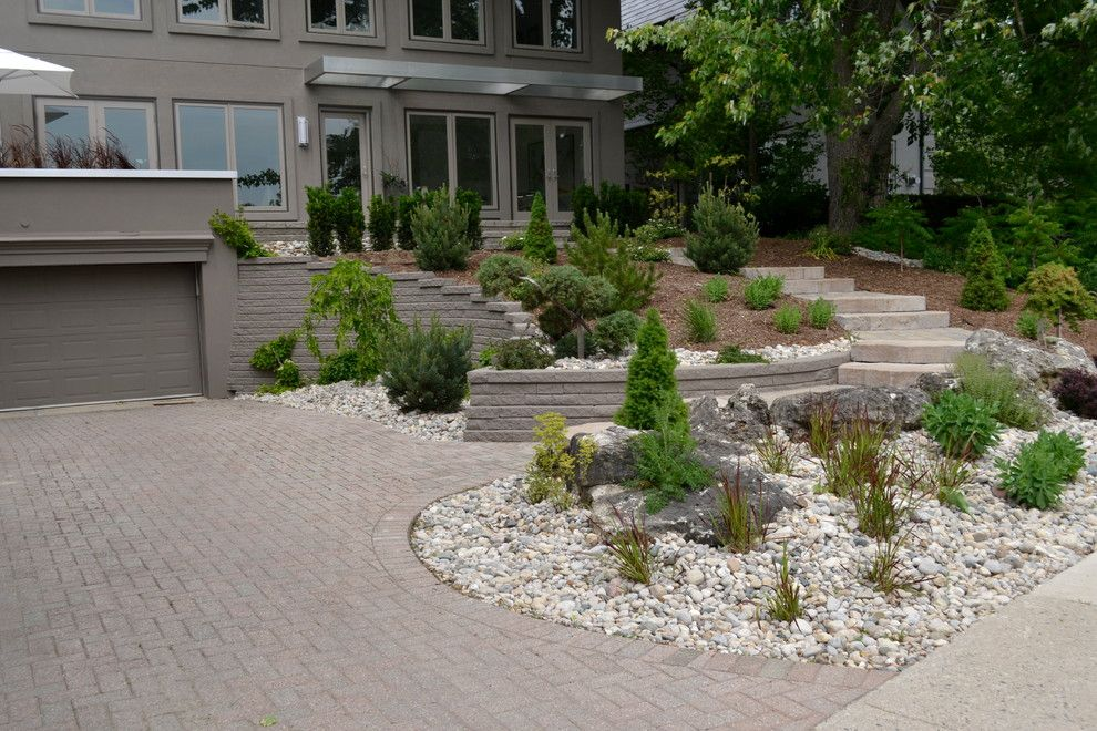 Pavestone for a Rustic Landscape with a Rustic Steps and William Street Front Entrance by Ross Yantzi's Pavestone Plus Ltd.