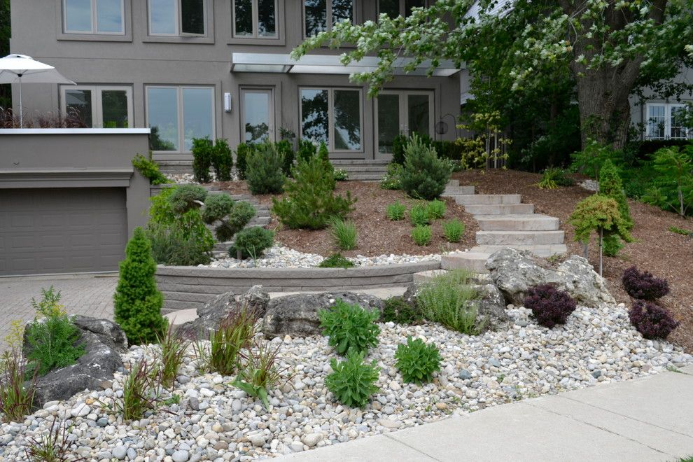 Pavestone for a Rustic Landscape with a Staircase and William Street Front Entrance by Ross Yantzi's Pavestone Plus Ltd.