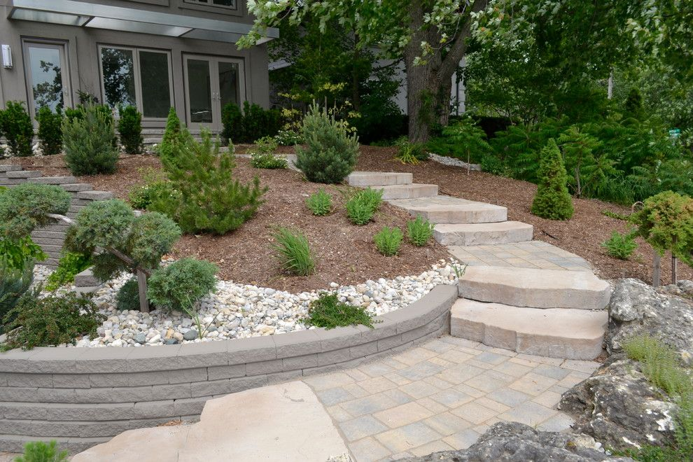 Pavestone for a Rustic Staircase with a Rock Wall and William Street Front Entrance by Ross Yantzi's Pavestone Plus Ltd.