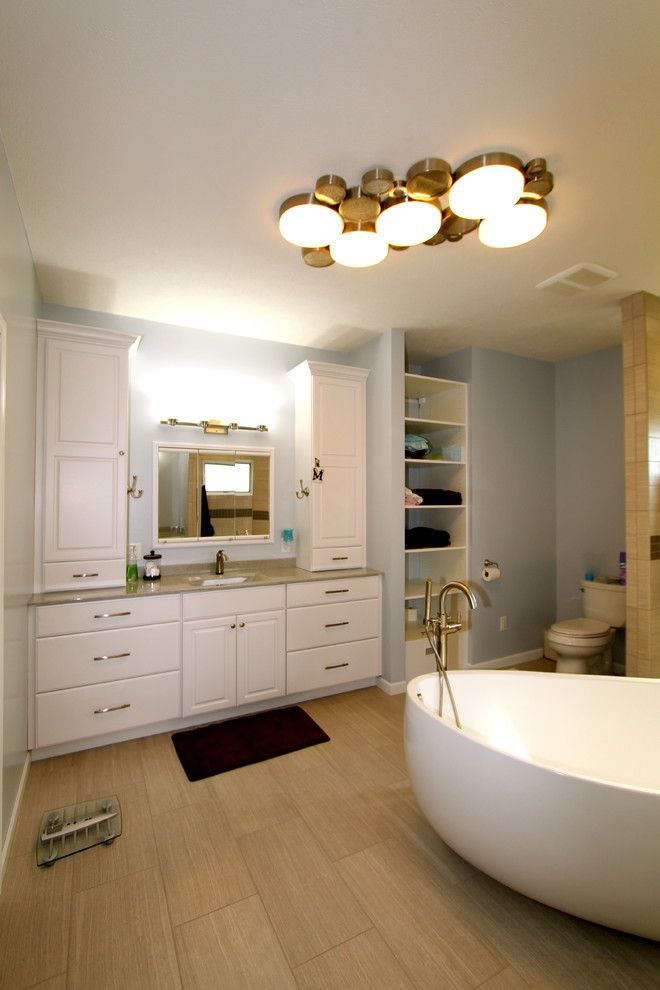 Pearle Vision Omaha for a Modern Bathroom with a Onyx Top and Great Modern Space by Merritt's Quality Cabinets
