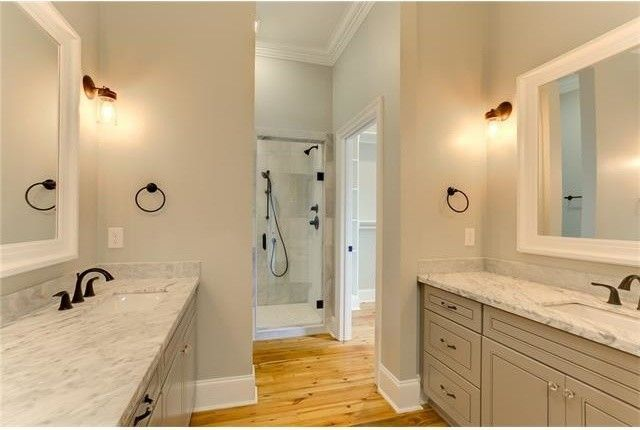 Penthouse New Orleans for a Transitional Bathroom with a Hardwood Flooring and Bathrooms by Ses Enterprises, Llc