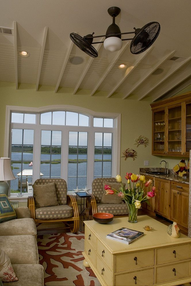 Pf Changs Waterfront for a Beach Style Family Room with a Wall Art and Knot on Call by Blue Sky Building Company