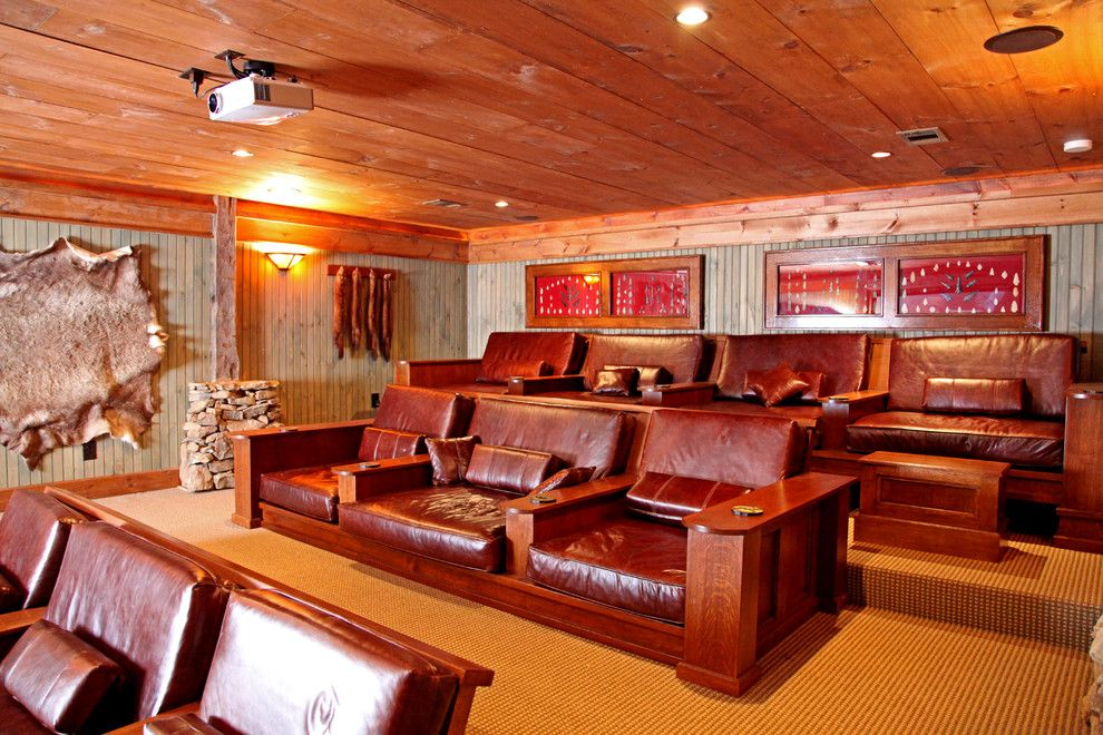 Phipps Movie Theater for a Rustic Home Theater with a Leather Arm Chairs and Lakeside Lodge by Appalachian Antique Hardwoods
