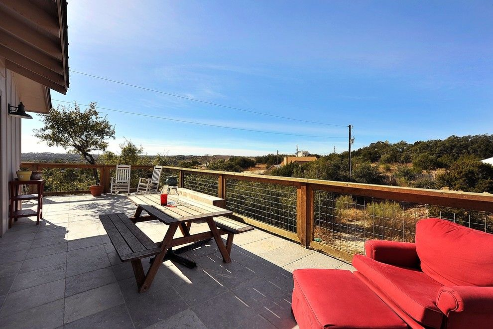 Picket Fence Realty for a Craftsman Deck with a Wire Railing and Hill Country Guest House by Capstone Custom Homes