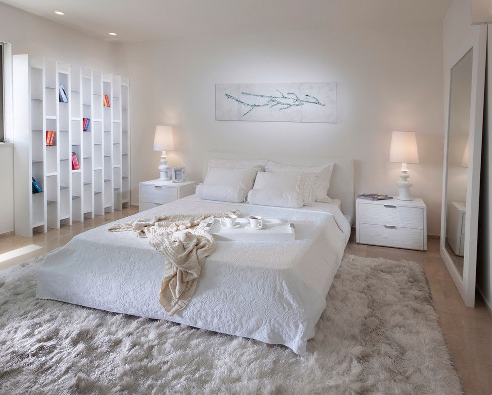 Pilings for a Contemporary Bedroom with a White Bedroom and Bedroom by Elad Gonen