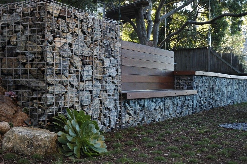 Pilings for a Contemporary Landscape with a Stone and Serpentine Stone by Jeffrey Gordon Smith Landscape Architecture