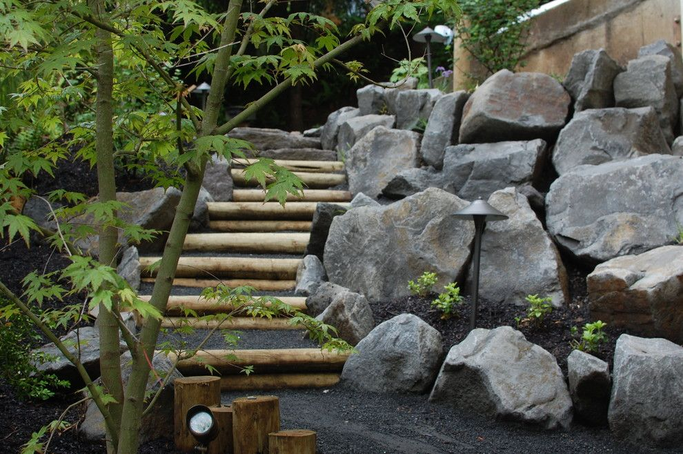 Pine Bluff Sand and Gravel for a Eclectic Landscape with a Boulders and Wood and Stone Steps by Ross Nw Watergardens