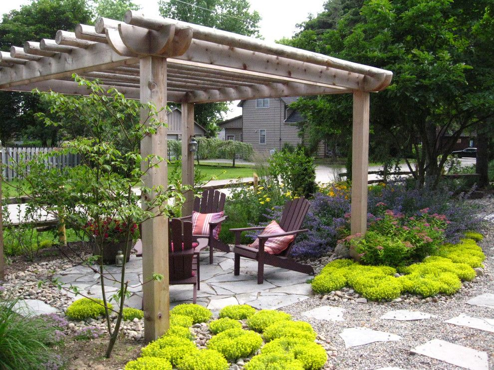 Pine Bluff Sand and Gravel for a Traditional Landscape with a Yard and Rustic Pergola by Genus Loci Ecological Landscapes Inc.