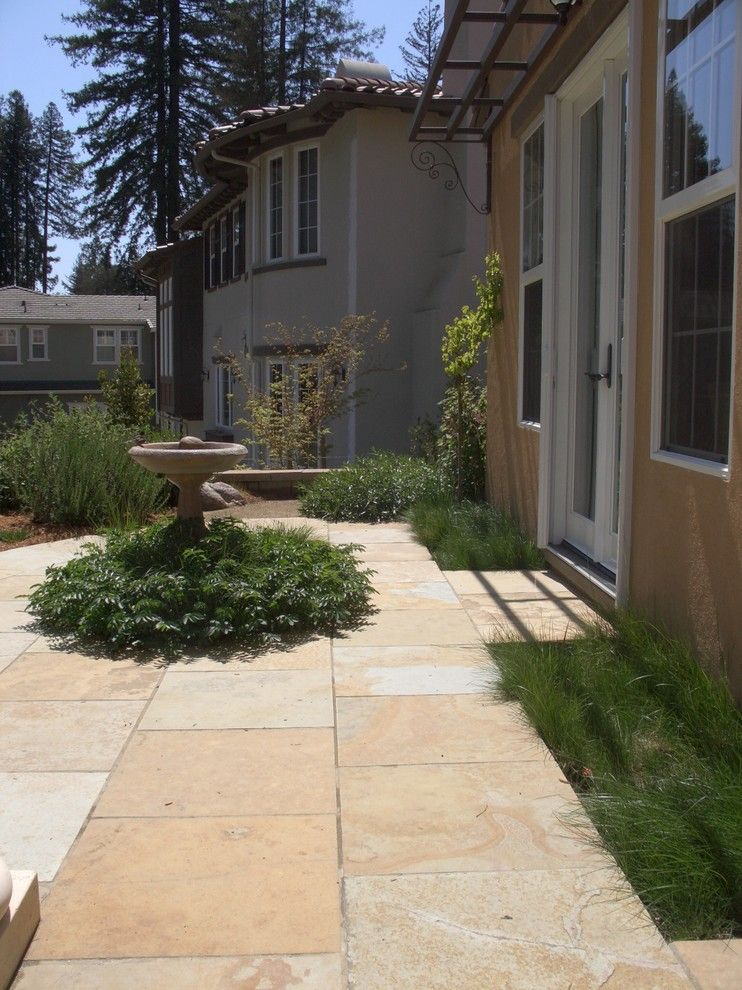 Planting Wildflowers for a Mediterranean Landscape with a Natural Stone Path and Andrews Residence by Wildflower Landscape Design