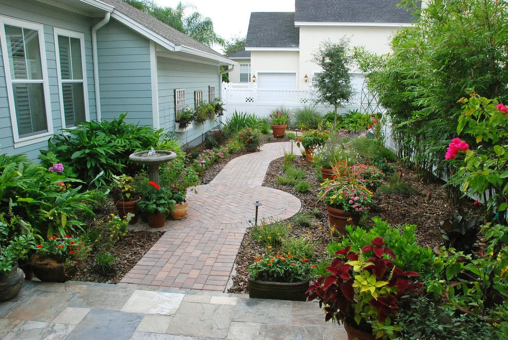 Pleasure Island Orlando for a Traditional Landscape with a Brick and Intimate Cottage Garden by Hortus Oasis