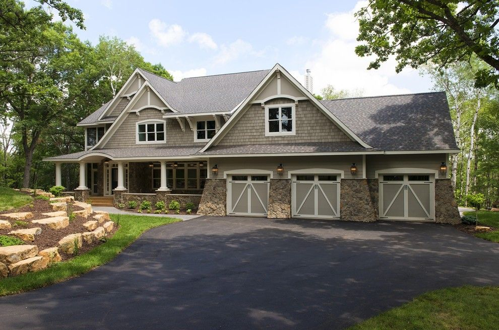 Plymouth Mn Weather for a Traditional Exterior with a Stone Columns and Hampton Cottage Style Home by Divine Custom Homes