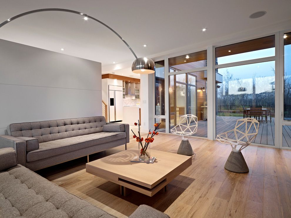 Plywood Plank Floor for a Contemporary Living Room with a Ceiling Lighting and Living Room by Habitat Studio