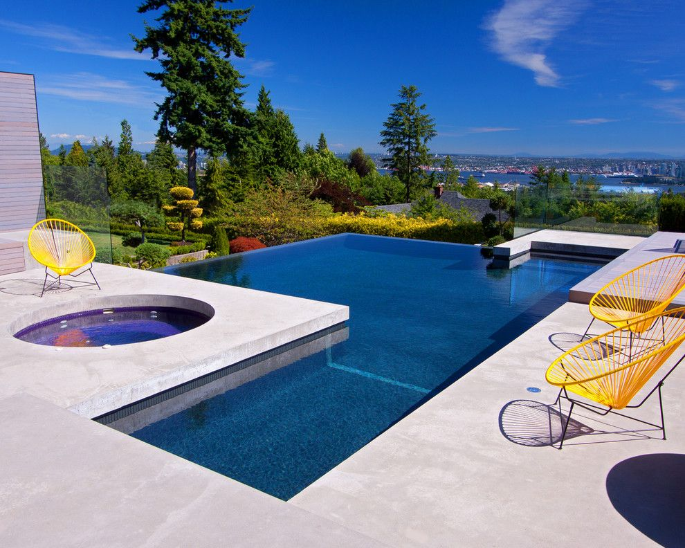Pool World Spokane for a Modern Pool with a Trampoline and Fitness or Fun   Best of Both Worlds by Alka Pool Construction Ltd