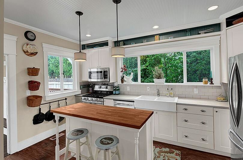 Popcorn Ceilings for a Farmhouse Kitchen with a Ikea Kitchen Laminate Counters Butcher Block Island Farmhous and Cottage Home by Missyslair