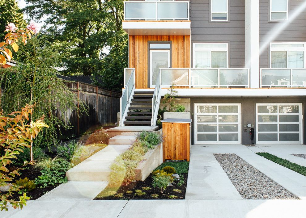 Portland Sand and Gravel for a Modern Landscape with a Wood Exterior and Modern Duplex Front Yard by Pistils Landscape Design + Build