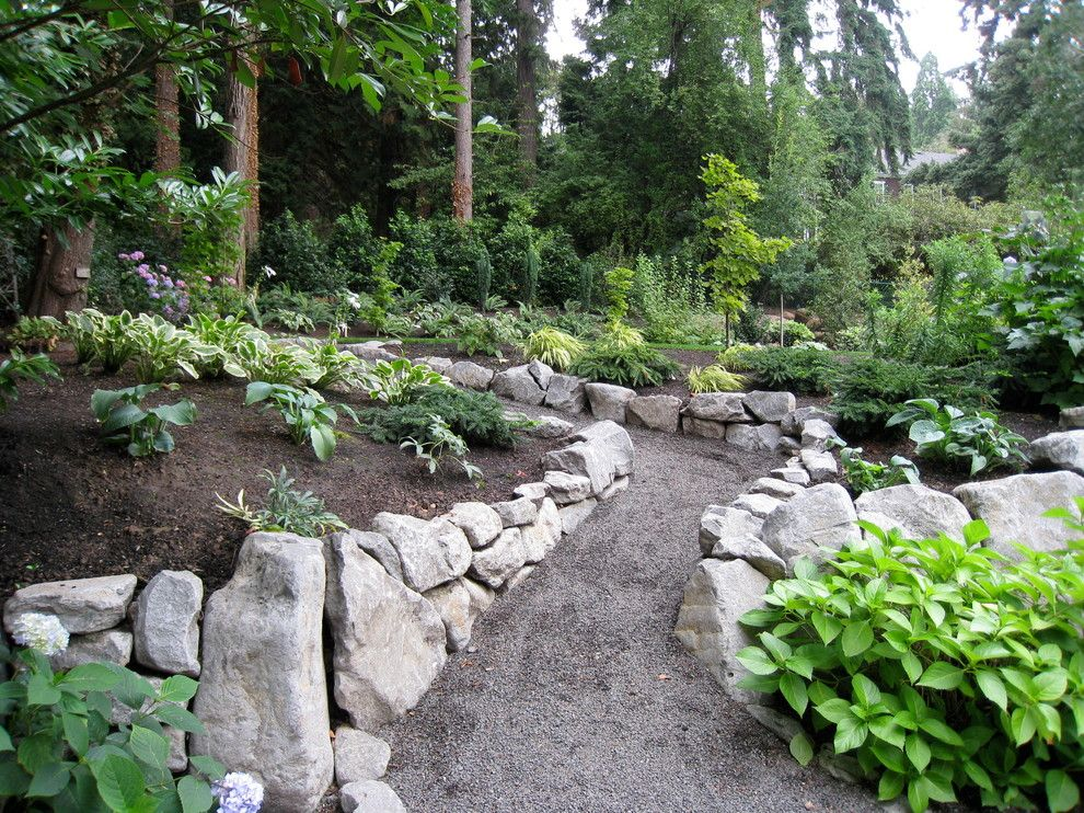 Portland Sand and Gravel for a Traditional Landscape with a Gravel Pathway and Hardscapes by Chinick Landscaping & Nursery