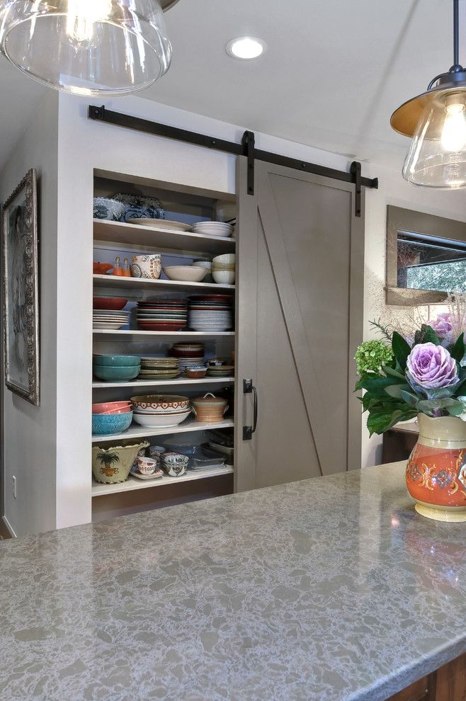 Pottery Barn Ornaments for a Transitional Kitchen with a Sliding Barn Door and Low Country by Robert Paige Cabinetry Llc