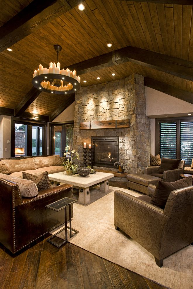 Power Home Remodeling Group Reviews for a Rustic Family Room with a Fireplace Mantel and Rustic Family Room by John Kraemer & Sons