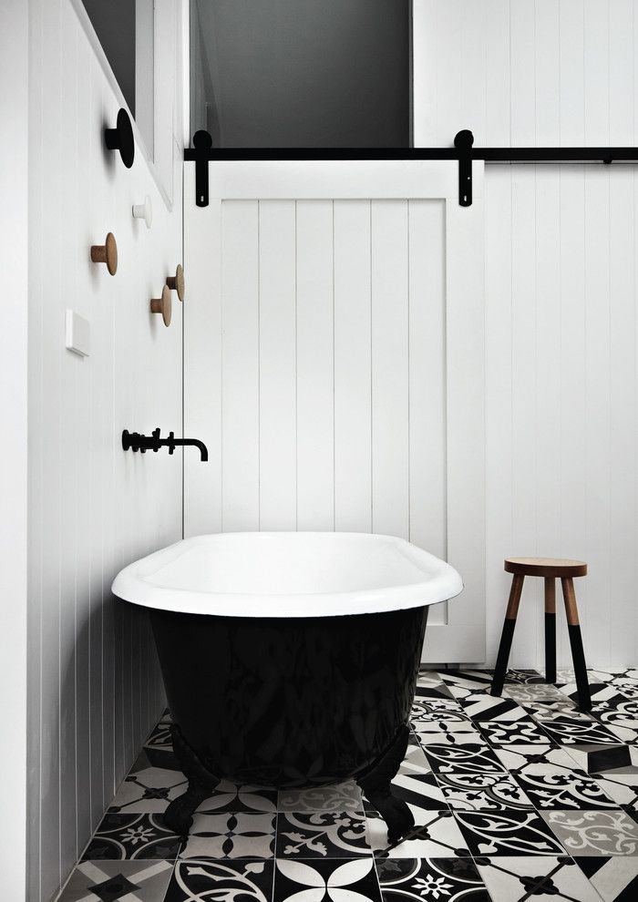 Proper Way to Hang American Flag for a Contemporary Bathroom with a Sliding Barn Door and Kerferd by Whiting Architects