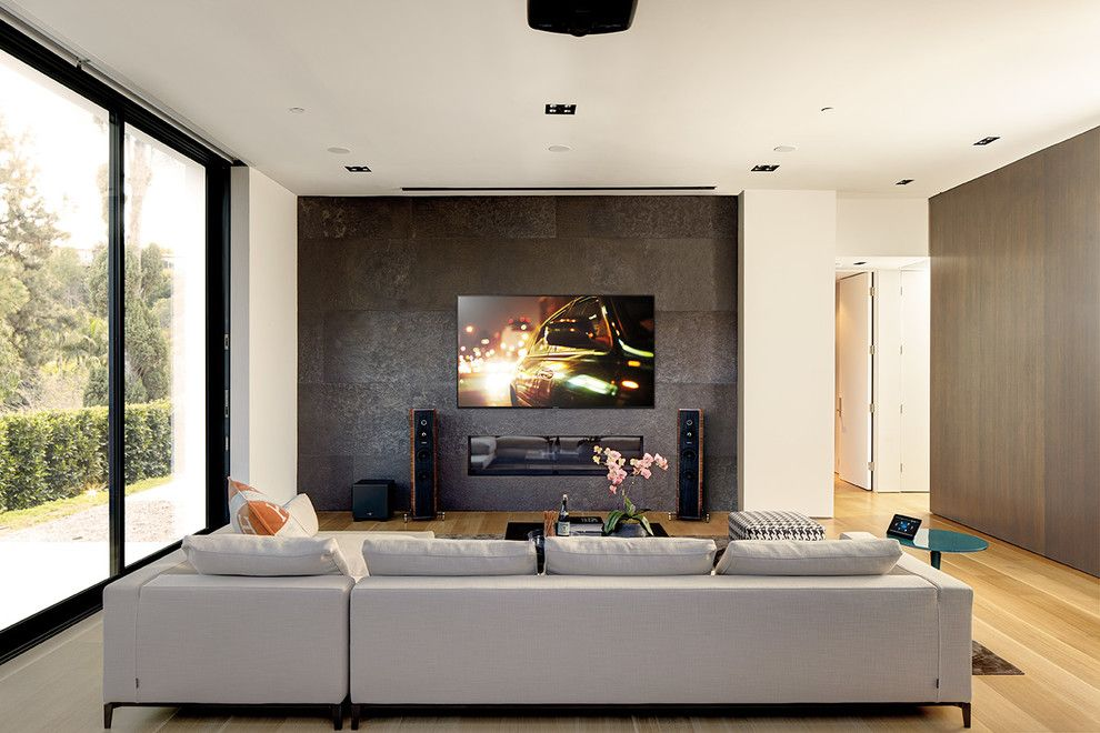 Provo Theater for a Modern Family Room with a Dark Accent Wall and Family Rooms by Magnolia Design Center