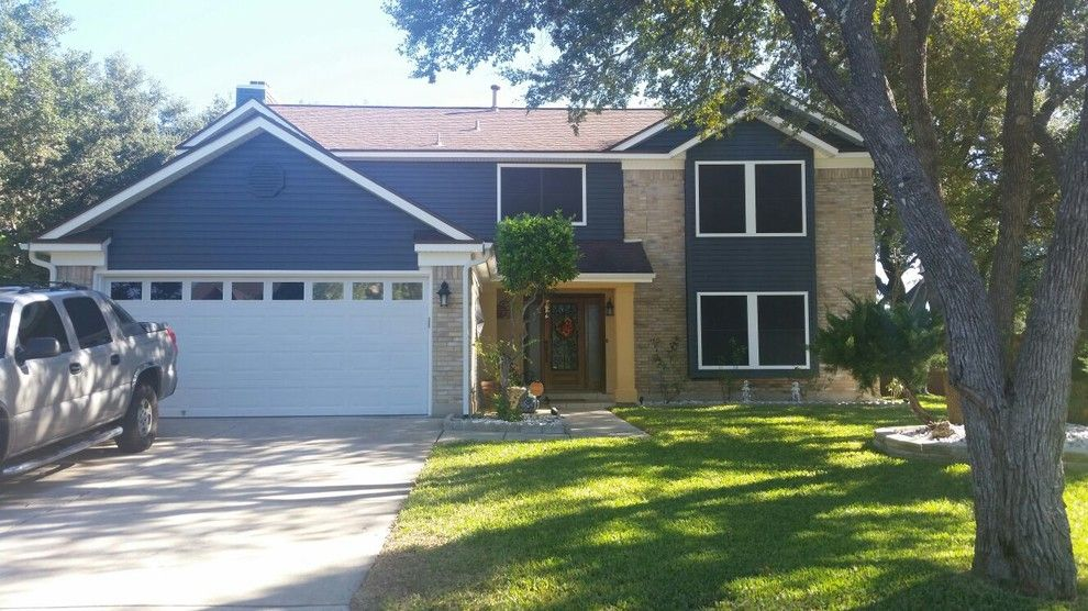 Pulte Homes Reviews for a Modern Exterior with a Front Entry Pathway and Window Replacement by Titan Remodeling
