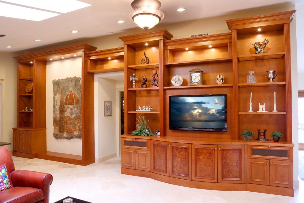 Pura Vida Miami for a Traditional Family Room with a Wall Unit and Traditional Entertainment Centers by Custom Artisan Cabinetry